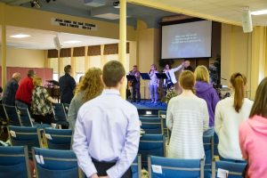 Church members worshiping