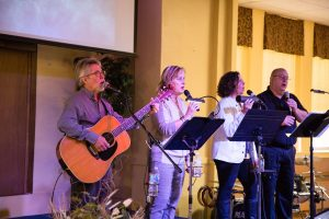Worship team singing and playing guitar